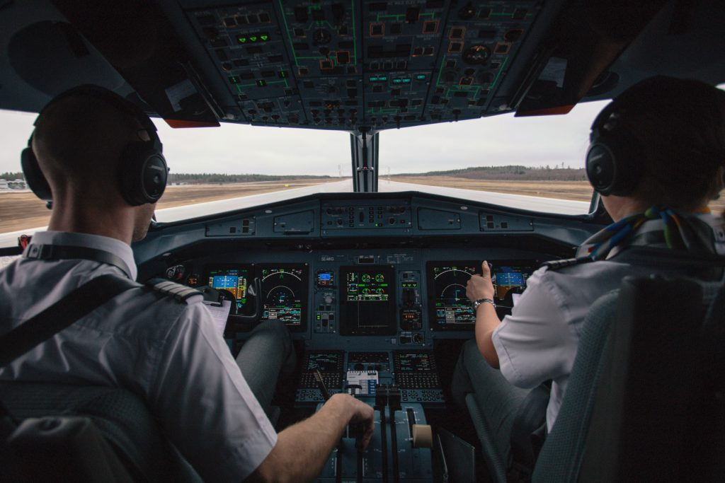 Photo of the First Officer at the controls of an airliner that just landed.
